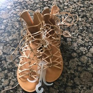 American eagle lace up women's sandals.
